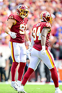 Landover, MD - September 16, 2018: Washington Redskins linebacker Ryan Kerrigan (91) and Washington Redskins linebacker Preston Smith (94) celebrate a tackle for a loss on Indianapolis Colts quarterback Andrew Luck (12) during game between the Indianapolis Colts and the Washington Redskins at FedEx Field in Landover, MD. The Colts defeated the Redskins 21-9.(Photo by Phillip Peters/Media Images International)