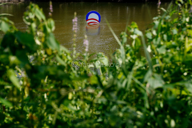 A sign for Democratic Presidential hopeful Barack Obama (D-IL) floats, intentionally placed in the water for viewing from his campaign event. Obama spoke in Manchester, Iowa, on July 14, 2007.