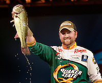 NWA Democrat-Gazette/BEN GOFF -- 04/26/15 Matt Arey, FLW pro from Shelby, N.C., holds up one of his bass during weigh-in on the final day of the Walmart FLW Tour at Beaver Lake at the John Q. Hammons Center in Rogers on Sunday Apr. 26, 2015. Arey won the event for the second year in a row with a four-day total of 55 lbs. 6 oz.