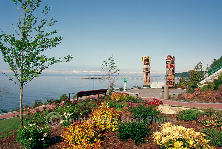 White Rock, BC, British Columbia, Canada - Seaside Promenade Walkway and Coast Salish and Haida Totem Poles in Lions Park along Semiahmoo Bay, Autumn / Fall (Model Released)