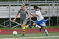 Philadelphia defender, Leigh Ann Robinson (7) dribbles past Boston defender, Stephanie Cox (14). The Philadephia Independence prevailed, 2-0 on a beatiful Mother's Day evening at Widener University in Chester, PA.