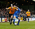 Danny Wright of Cambridge United and Zak Mills of Histon battle for possession during the Blue Square Bet Premier match between Cambridge United and Histon at the Abbey Stadium, Cambridge on 1st January, 2011.© Kevin Coleman 2011