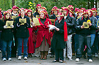 "Nov. 2, 2012; Students and faculty read from The Divine Comedy, concluding the ""Donte Now"" event at the Grotto. Italian Studies at Notre Dame and the College of Arts and Letters' and the William and Katherine Devers Program in Dante Studies hosted ""Dante Now"" at various locations around campus. Photo by Barbara Johnston/University of Notre Dame"