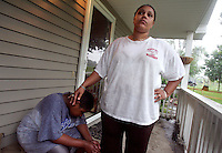 Natalie Leverette pats her rain-soaked son, Cameron, 12, on the head while their family works to empty and evacuate their home on SE 9th Street near the swelling Des Moines River Wednesday, June 11, 2008.