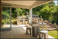 BNPS.co.uk (01202 558833)<br /> Pic: UniqueHomeStays/BNPS<br /> <br /> Basically concrete everything.....<br /> <br /> Bomb proof hideaway - the perfect place to cement a relationship...<br /> <br /> A concrete carport has been transformed into a ultra cool luxury staycation bolt hole - with even its fireplace, kitchen worktops and bath made from concrete. <br /> <br /> The Hide is perfect for romantic weekends away or creative solo escapes but it will set the minimalist traveller back up to &pound;2,350 a week in peak season.<br /> <br /> Despite its slightly industrial appearance, it is actually a cosy rural retreat, surrounded by nature at the end of a winding country lane three miles from Perranporth beach in north Cornwall.<br /> <br /> Unique Home Stays used a bird hide as the inspiration with quirky stick-out windows that allow guests to stargaze from the bed and lighting designed to replicate the effect of sunlight through trees.
