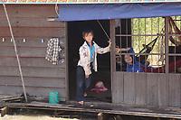 Mekong River<br /> , Cambodia - 2007 File Photo -<br /> <br /> <br />  fishing village children  on boat.   <br /> <br /> <br /> <br /> photo : James Wong-  Images Distribution