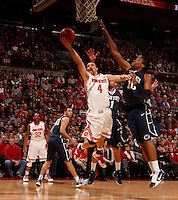 Ohio State Buckeyes guard Aaron Craft (4) goes up against Penn State Nittany Lions forward Brandon Taylor (10) in the first half at Value City Arena in Columbus Jan. 29, 2013 (Dispatch photo by Eric Albrecht)