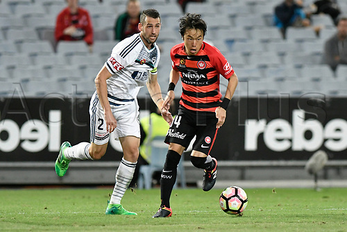 April 8th 2017, ANZ Stadium, Sydney, Australia; A-League football, Western Sydney Wanderers versus Melbourne Victory; Wanderers midfielder Jumpei Kusukami goes past Victory captain Carl Valeri; The match  ended in a 0-0 draw;