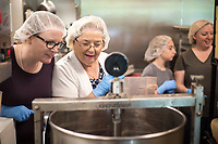NWA Democrat-Gazette/CHARLIE KAIJO Jessica Minton of Bentonville (from right) and Sue Yarbrough of Rogers  watch chocolate being made, Sunday, May 13, 2018 at Markham &amp; Fitz Chocolate in Bentonville. <br />