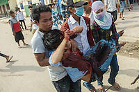 03 January, 2014 - Phnom Penh. A badly gun wounded man is taken away by some of the other protesters. © Thomas Cristofoletti / Ruom 2014