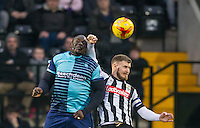 Adebayo Akinfenwa of Wycombe Wanderers & Michael O'Connor of Notts Co in the air during the Sky Bet League 2 match between Notts County and Wycombe Wanderers at Meadow Lane, Nottingham, England on 10 December 2016. Photo by Andy Rowland.
