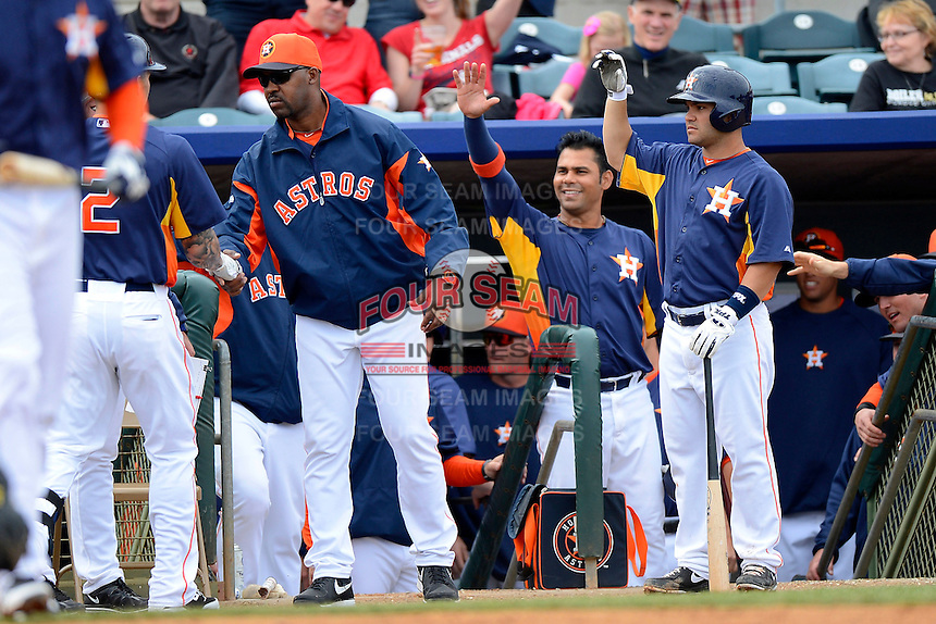 Houston Astros manager Bo Porter #16, Carlos Pena #12, and Jose Altuve #27 greet Brandon Barnes #2 after scoring a run during a Spring Training game against the St. Louis Cardinals at Osceola County Stadium on March 1, 2013 in Kissimmee, Florida.  The game ended in a tie at 8-8.  (Mike Janes/Four Seam Images)