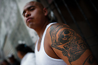 A Mexican follower of Santa Muerte (Saint Death) shows his tattoo during a religious pilgrimage in Tepito, a rough district of Mexico City, Mexico, 1 May 2011. The religious cult of Santa Muerte is a syncretic fusion of Aztec death worship rituals and Catholic beliefs. Born in lower-class neighborhoods of Mexico City, it has always been closely associated with crime. In the past decades, original Santa Muerte's followers (such as prostitutes, pickpockets and street drug traffickers) have merged with thousands of ordinary Mexican Catholics. The Saint Death veneration, offering a spiritual way out of hardship in the modern society, has rapidly expanded. Although the Catholic Church considers the Santa Muerte's followers as devil worshippers, on the first day of every month, crowds of believers in Saint Death fill the streets of Tepito. Holding skeletal figurines of Holy Death clothed in a long robe, they pray for power healing, protection and favors and make petitions to 'La Santísima Muerte', who reputedly can make life-saving miracles.