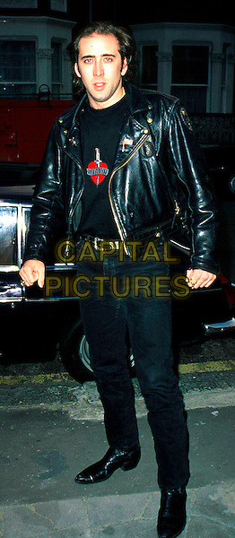 NICOLAS CAGE.Ref: 043.black leather jacket, balck jeans, black boots, full length, nicholas, full-length.www.capitalpictures.com.sales@capitalpictures.com.©Capital Pictures