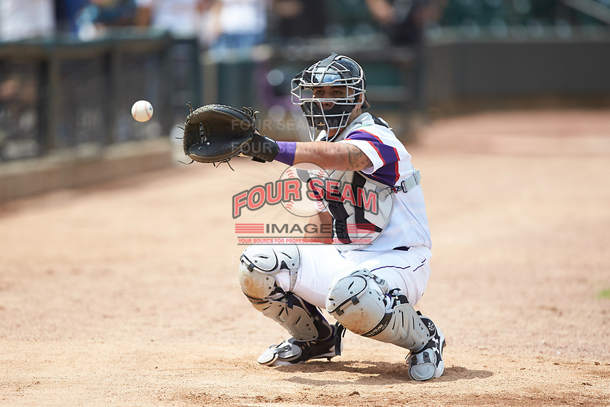 Winston-Salem Rayados catcher Daniel Gonzalez (17) warms up the starting pitcher in the bullpen prior to the game against the Potomac Nationals at BB&T Ballpark on August 12, 2018 in Winston-Salem, North Carolina. The Rayados defeated the Nationals 6-3. (Brian Westerholt/Four Seam Images)