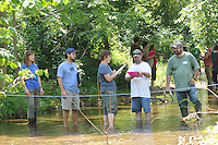 NWA Democrat-Gazette/FLIP PUTTHOFF <br /> Sabrina Bowman with Beaver Water District (left) helps Stream Smart volunteers, including Heather Harvey (third from left) measure the flow rate of Prairie Creek.
