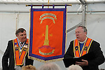 Jack Leetch and Reverend Mervin Gibson pictured with the new banner at the Orange Order march at Oldbridge. Photo: Colin Bell/pressphotos.ie