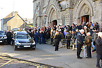 12/11/2013 – Part of the large crowd that gathered to say farewell to well known and much loved local poet Paddy Cluskey after his funeral at St. Mary's Church.