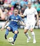 Getafe's Alvaro Vazquez (l) and Real Madrid's Pepe during La Liga match. April 16,2016. (ALTERPHOTOS/Acero)