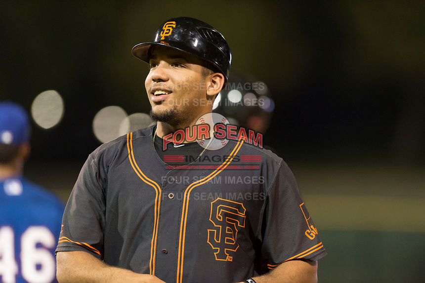 AZL Giants Black Franklin Labour (49) coaches first base during an Arizona League game against the AZL Rangers at Scottsdale Stadium on August 4, 2018 in Scottsdale, Arizona. The AZL Giants Black defeated the AZL Rangers by a score of 6-3 in the second game of a doubleheader. (Zachary Lucy/Four Seam Images)