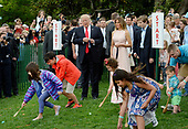 United States President Donald Trump , First Lady Melania Trump and son Barron watch the start an egg roll during the annual Easter Egg Roll on the South Lawn of the White House  in Washington, DC, on April 17, 2017. <br /> Credit: Olivier Douliery / Pool via CNP