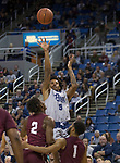 Nevada guard Nisre Zouzoua (5) takes a jump shot against Little Rock in the second half of an NCAA college basketball game in Reno, Nev., Friday, Nov. 16, 2018. (AP Photo/Tom R. Smedes)