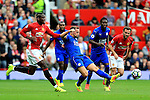 Daniel Drinkwater of Leicester City passes under pressure from Paul Pogba of Manchester United  during the Premier League match at Old Trafford Stadium, Manchester. Picture date: September 24th, 2016. Pic Sportimage