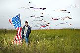 USA, Washington State, Long Beach Peninsula, portrait of kite flyer Connor Doran at the International Kite Festival, Connor performed on Americas Got Talent and uses his flying to ease the symptoms of his epilepsy