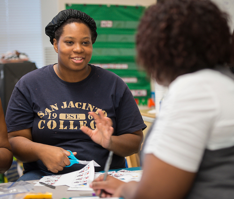 Santrice Jones works with parents of her Pre-K students during an Academic Parent Teacher Team (APTT) session at Fonwood Early Childhood Center, May 8, 2014.