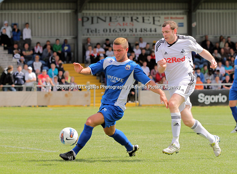 Pictured L-R: Kye Edwards of Port Talbot closely marked by Craig Beattie of Swansea. Saturday 17 July 2011<br /> Re: Pre season friendly, Port Talbot Football Club v Swansea City FC at the GenQuip ground, Port Talbot, south Wales.