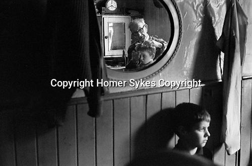 Boy having hair cut Belfast Ireland 1970