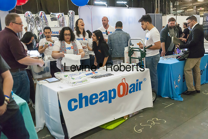 Workers from CheapOair at their table at the TechDay New York event on Tuesday, April 18, 2017. Thousands attended to seek jobs with the startups and to network with their peers. TechDay bills itself as the U.S.'s largest startup event with over 500 exhibitors. (© Richard B. Levine)