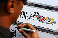 Aug. 18, 2013; Brainerd, MN, USA: Detailed view as NHRA top fuel dragster driver Antron Brown signs an autograph during the Lucas Oil Nationals at Brainerd International Raceway. Mandatory Credit: Mark J. Rebilas-