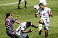 Swansea City's Ben Cabango (right) heads under pressure from Leeds United's Helder Costa <br /> <br /> Photographer Andrew Kearns/CameraSport<br /> <br /> The EFL Sky Bet Championship - Swansea City v Leeds United - Sunday 12th July 2020 - Liberty Stadium - Swansea<br /> <br /> World Copyright © 2020 CameraSport. All rights reserved. 43 Linden Ave. Countesthorpe. Leicester. England. LE8 5PG - Tel: +44 (0) 116 277 4147 - admin@camerasport.com - www.camerasport.com