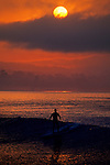Surfer at sunrise in Monterey Bay near Capitola Beach, Santa Cruz County, CALIFORNIA