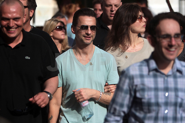 Dave Gahan, baritone lead singer for the popular Depeche Mode band, is seen with his wife, Jennifer Sklias-Gahan, while touring with the band in Jerusalem's old city, Friday, May 8th, 2009. Israeli fans have been excitedly anticipating the arrival of the popular British electronic music band, who only two years ago cancelled a scheduled performance in Israel due to the outbreak of the second Lebanon war. The band members arrived in Israel on Thursday evening, and will stay until after their concert, which will take place Sunday evening the 10th, at the Ramat Gan Stadium. Photo By: Emil Salman / JINI.
