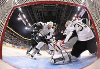 San Antonio Rampage defenseman Ryan Whitney clears the puck from the crease in front of Rampage goaltender Jacob Markstrom during the first period of an AHL hockey game against the Milwaukee Admirals, Thursday, Jan. 16, 2014, in San Antonio (Darren Abate/AHL)