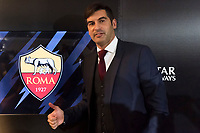 Paulo Fonseca poses in front of the symbol of AS Roma at the end of the press conference. <br /> Roma 08/07/2019 Centro Sportivo Trigoria <br /> Press Conference <br /> Football Calcio Serie A 2019/2020 <br /> Photo Andrea Staccioli / Insidefoto