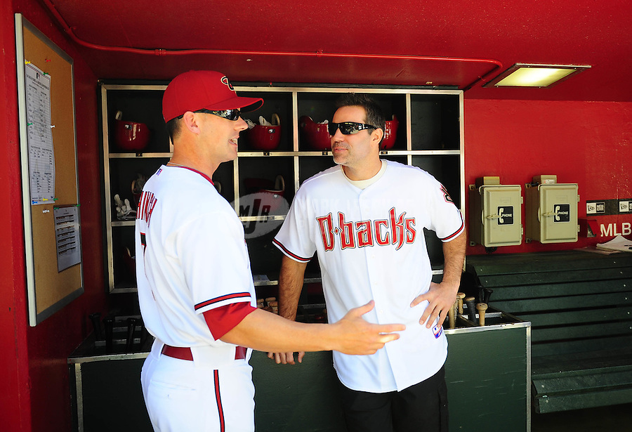 Apr. 5, 2010; Phoenix, AZ, USA; Arizona Cardinals former quarterback Kurt Warner (right) talks with Arizona Diamondbacks manager A.J. Hinch prior to throwing out the first pitch for the game against the San Diego Padres during opening day at Chase Field. Mandatory Credit: Mark J. Rebilas-