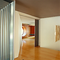 Access to this extraordinary house is by means of a vast electric, pivoting steel entrance door