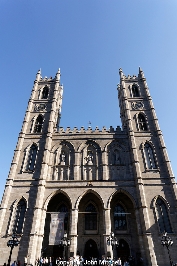 Gothic Revival facade of Notre Dame Basilica on Place d'Armes, Old Montreal Quebec, Canada