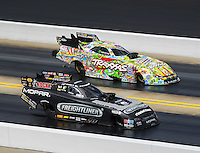 Sep 18, 2016; Concord, NC, USA; NHRA funny car driver Matt Hagan (near) races alongside Courtney Force during the Carolina Nationals at zMax Dragway. Mandatory Credit: Mark J. Rebilas-USA TODAY Sports