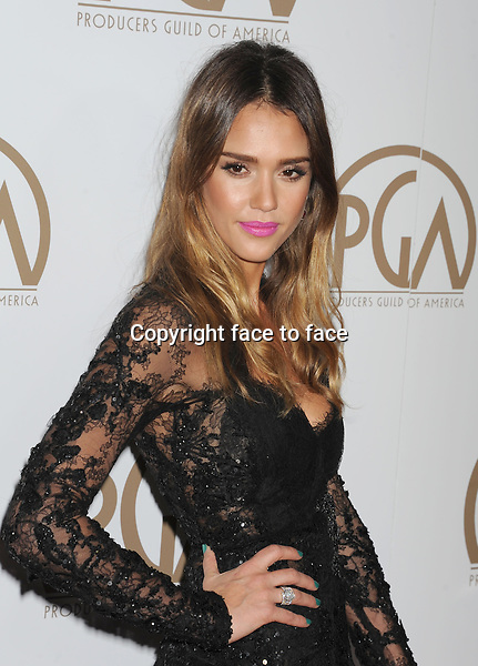 BEVERLY HILLS, CA - JANUARY 26: Jessica Alba Elie Saab Couture fall 2012 sheer lace black gown with a dense flower applique all over the bodice arrives at the 24th Annual Producers Guild Awards at The Beverly Hilton Hotel on January 26, 2013 in Beverly Hills, California...Credit: Mayer/face to face..- No Rights for USA, Canada and France -