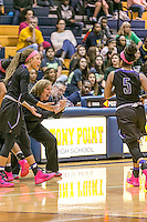 Cedar Ridge head coach Angela Beck celebrates a scoring run against Stony Point Friday.  The Raiders crushed the Tigers 75-37.  (LOURDES M SHOAF for Round Rock Leader.)