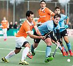 WASSENAAR - Hoofdklasse hockey heren, HGC-Bloemendaal (0-5)  Jamie Dwyer (Bldaal) met rechts Willem Rath (HGC)     COPYRIGHT KOEN SUYK