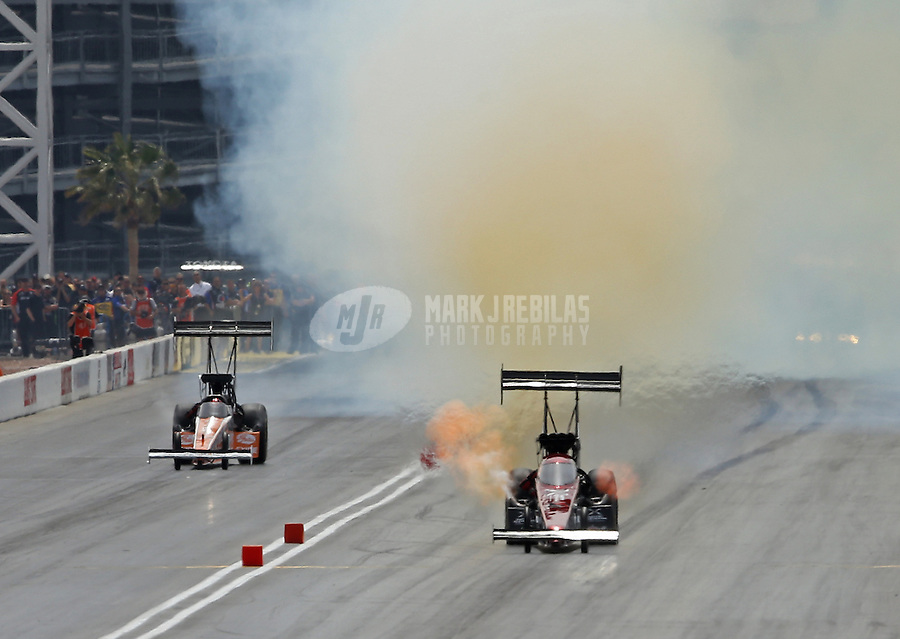 Apr. 7, 2013; Las Vegas, NV, USA: NHRA top fuel dragster driver Spencer Massey (right) defeats Clay Millican during the Summitracing.com Nationals at the Strip at Las Vegas Motor Speedway. Mandatory Credit: Mark J. Rebilas-