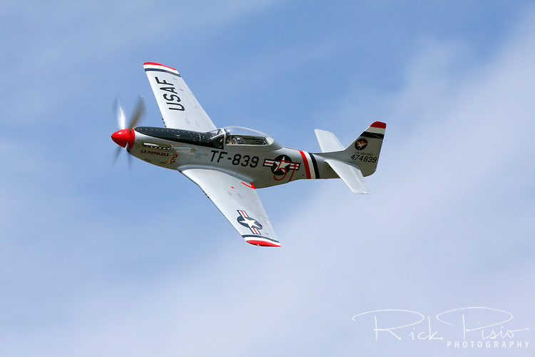 """P-51 Mustang """"La Pistolera"""" flown by Rod Lewis during a practice session at the 2010 Pylon Racing School at Stead Field in Nevada."""