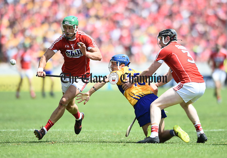 Shane O Donnell of Clare in action against Christopher Joyce and Damien Cahalane of Cork during their Munster senior hurling final at Thurles. Photograph by John Kelly.