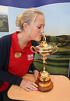 Kate Whitmore of the Celtic Manor Resort kisses the Ryder Cup at the Visit Scotland stand in the tented village on the final day of the 2013 ISPS Handa Wales Open from the Celtic Manor Resort, Newport, Wales. Picture:  David Lloyd / www.golffile.ie