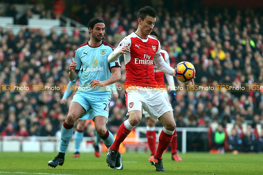 Gabriel Paulista of Arsenal and George Boyd of Burnley during Arsenal vs Burnley, Premier League Football at the Emirates Stadium on 22nd January 2017